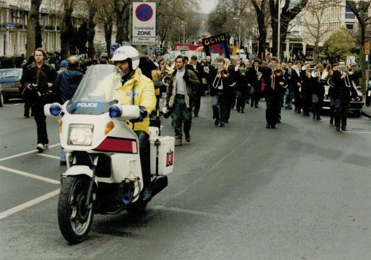 As part of the Trades Union Congress protest against the prohibition of Government Communications Head Quarters workers being allowed Trade Union membership, a series of marches took place annually through Cheltenham, in January. Police Constable Martyn Hillier riding   J82CVJ which was put on the road in December 1991, so this is the 1992 march. (Gloucestershire Police Archives URN 2269) | Photograph from Martyn Hillier